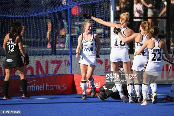 Pia Maertens of Germany is congratulated by team mates after scoring during the Women's FIH Field Hockey Pro League match between New Zealand v...