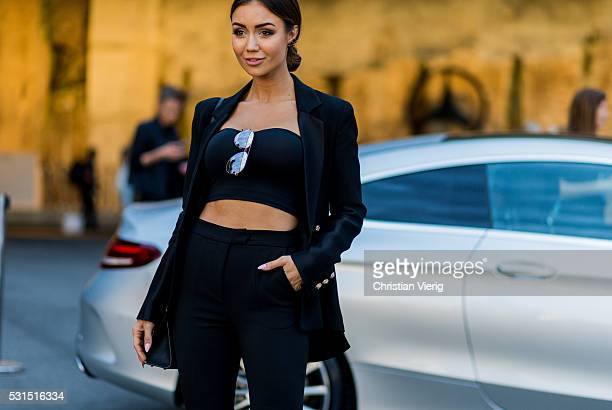 Pia Muehlenbeck wearing a black cropped shirt blazer and pants from Rachel Gilbertau and Dior Sunglasses outside Toni Maticevski at MercedesBenz...