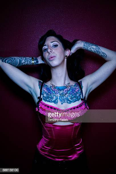 Pia Phelps displays her tattoos at the 12th Annual New York City Tattoo Convention at Roseland Ballroom in Manhattan