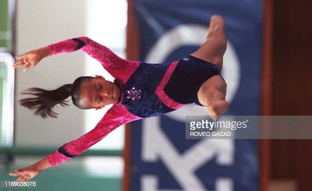 Pia Reyes of the Philippines in action at the balance beam of the women's gymnastic finals at the19th Southeast Asian Games 16 October Reyes and...