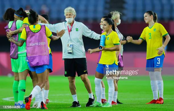 Pia Sundhage, Head Coach of Team Brazil celebrates with his players after victory in the Women's First Round Group F match between China and Brazil...