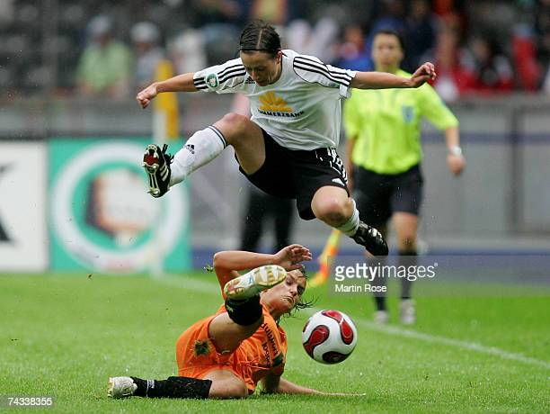 Pia Wunderlich of Frankfurt and Lira Bajramaj of Duisburg fight for the ball during the Women's DFB German Cup final between 1FFC Frankfurt and FCR...