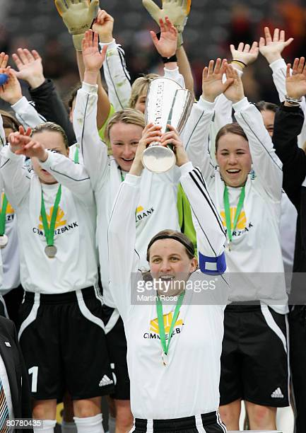 Pia Wunderlich of Frankfurt celebrates with the trophy after winning the Women's DFB German Cup final between 1FC Saarbruecken and 1FFC Frankfurt at...