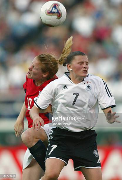 Pia Wunderlich of Germany and Cindy Parlow of the USA clash for a head ball during the semifinals of the FIFA Women's World Cup match on October 5...
