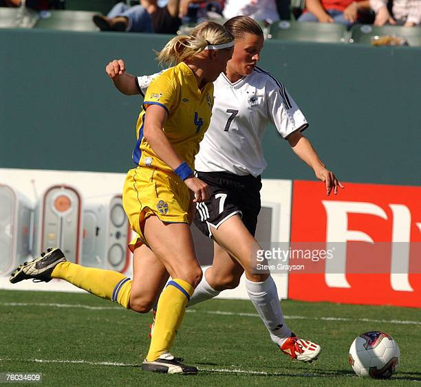 Pia Wunderlich of Germany and Hanna Marklund in action in the first half