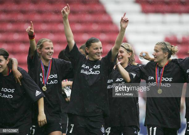 Pia Wunderlich of Germany celebrates with team mates after victory over Norway in the Final of the Women's UEFA European Championship 2005 game...