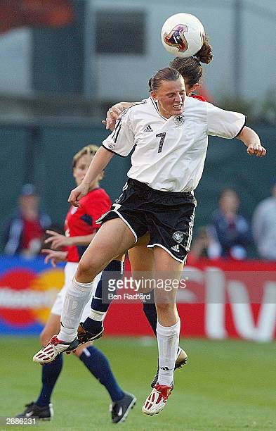 Pia Wunderlich of Germany heads the ball over the defense of the USA during the semifinals of the FIFA Women's World Cup match on October 5 2003 at...