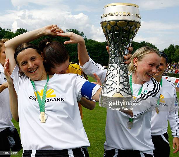 Pia Wunderlich Stephanie Ullrich and Conny Pohlers of 1FFC Frankfurt celebrate winning the women Bundesliga match between 1FFC Frankfurt and SG Essen...