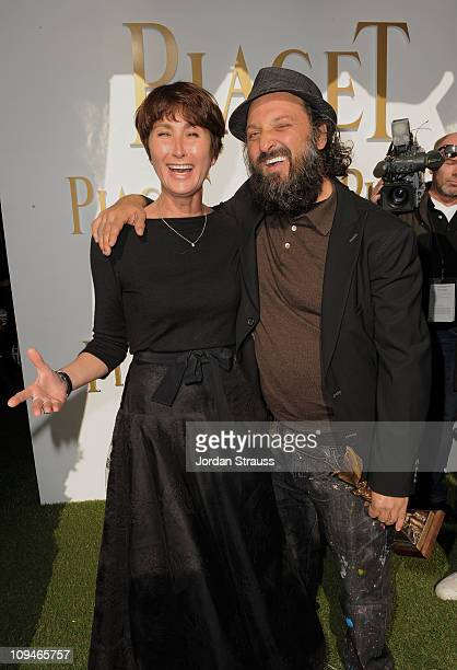 Piaget PR Manager Natacha Hertz and artist/filmmaker Thierry Guetta winner of Best Documentary award for 'Exit Through the Gift Shop' in the Piaget...