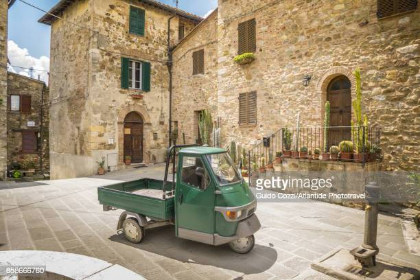 A Piaggio Ape parked in an alley of the village