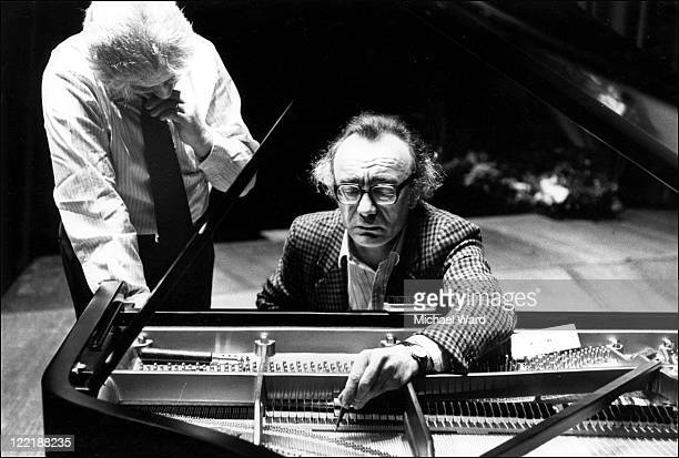 Pianist Alfred Brendel and piano technicain Bob Glazebrook 'voicing' the piano to adjust the instrument's tone Queen Elizabeth Hall 1982
