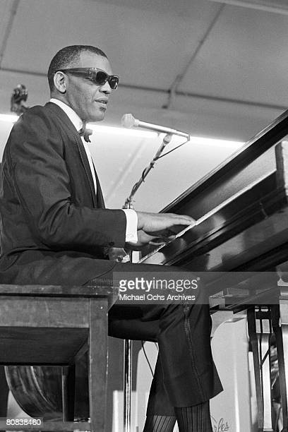 Pianist and entertainer Ray Charles performs onstage with his orchestra at Sound Blast '66 at Yankee Stadium on June 10 1966 in New York City New York