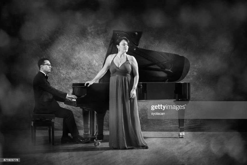 Pianist and singer during stage performance : Stock Photo