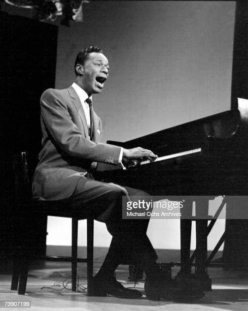 Pianist and singer Nat King Cole performs on the Ed Sullivan Show on April 13 1958 in New York City New York