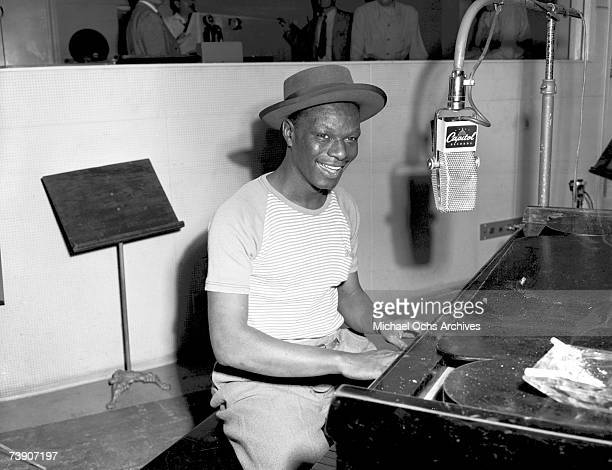 Pianist and singer Nat King Cole records at Capitol Records Studios on May 23 1946 in Los Angeles California