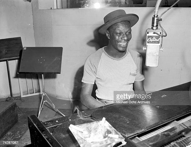Pianist and singer Nat 'King' Cole records at Capitol Records Studios on May 23 1946 in Los Angeles California