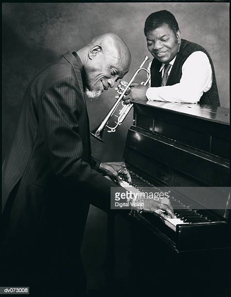 Pianist and trumpet player talking together