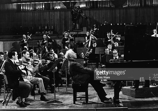 Pianist Arthur Rubenstein rehearsing with an orchestra for tonight's gala performance at Royal Festival Hall London December 7th 1967