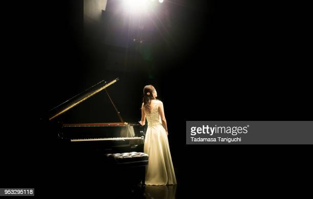 pianist at the stage - entertainment occupation stock pictures, royalty-free photos & images