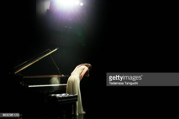 Pianist at the stage with grand piano