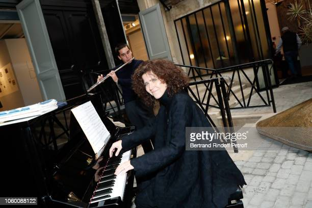 Pianist Bettina Bocchese and Flutist Andrea Vecchiato perform during Alaia Foundation Library Opening at Gallery Azzedine Alaia on November 10 2018...