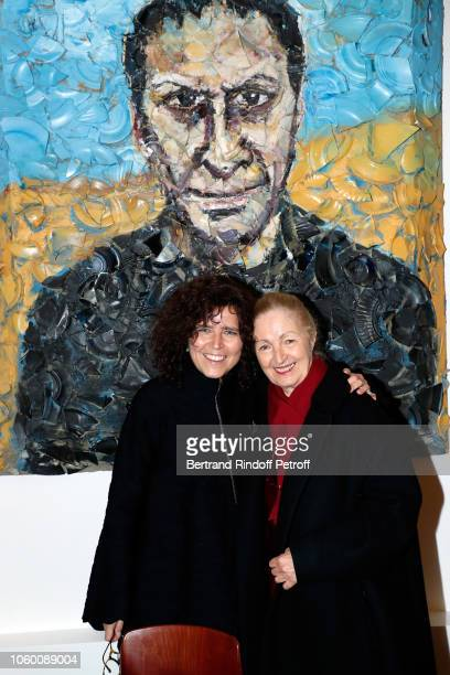 Pianist Bettina Bocchese and her mother Silvia Bocchese pose in front of a portrait of Azzedine Alaia by Julian Schnabel during Alaia Foundation...