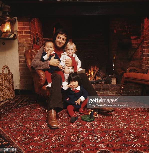 Pianist conductor and composer Andre Previn photographed with his children with Mia Farrow 1975