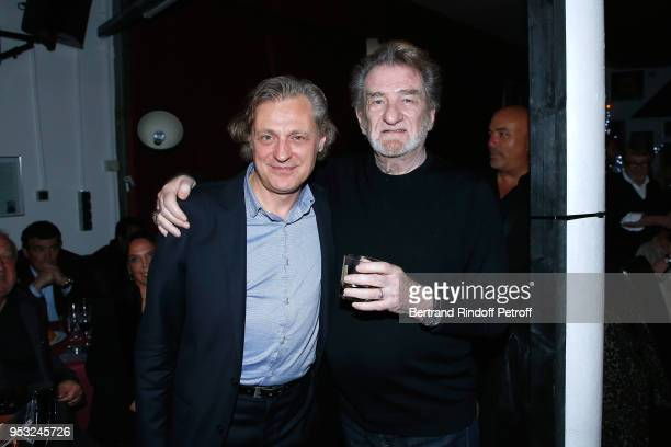 Pianist Dimitri Naiditch and Eddy Mitchell attend the Dinner in honor of Nathalie Baye at La Chope des Puces on April 30 2018 in SaintOuen France
