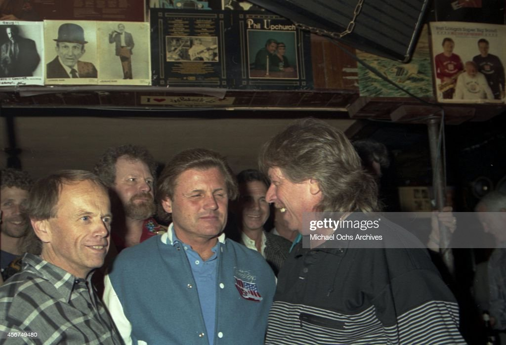 Pianist Don Randi poses for a portrait with Al Jardine and Bruce Johnston of the rock and roll band 'The Beach Boys' at a Hal Blaine book release party at Mr. Randi's club 'The Baked Potato' on April 19, 1990 in Los Angeles, California.