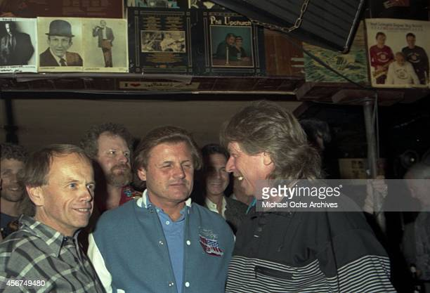 Pianist Don Randi poses for a portrait with Al Jardine and Bruce Johnston of the rock and roll band The Beach Boys at a Hal Blaine book release party...