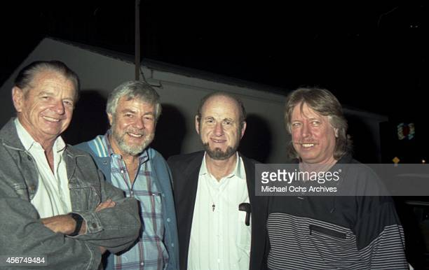 Pianist Don Randi with 3 men at a Hal Blaine book release party at Mr Randi's club The Baked Potato on April 19 1990 in Los Angeles California