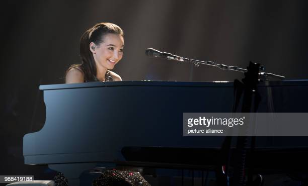 Pianist Emily Bear performs on a grand piano on stage during the 'Night Of The Proms' at the Barclaycard Arena venue in Hamburg Germany 1 December...