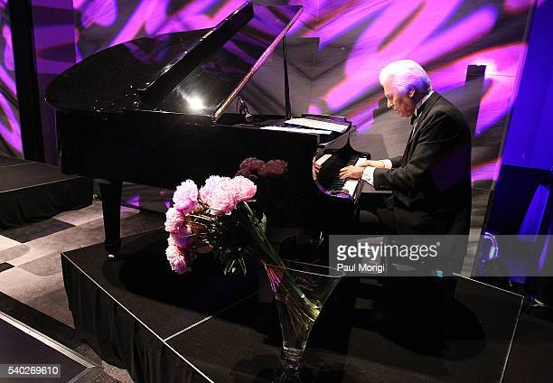 Pianist George Gerich performs at the grand reopening party of the iconic Watergate Hotel on June 14 2016 in Washington DC