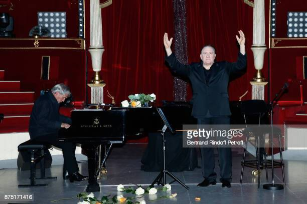 Pianist Gerard Daguerre and Gerard Depardieu acknowledge the applause of the audience at the end of 'Depardieu Chante Barbara' at 'Le Cirque D'Hiver'...
