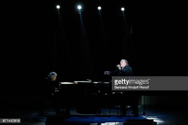 Pianist Gerard Daguerre and Gerard Depardieu perform during Depardieu Chante Barbara at Le Cirque d'Hiver on November 6 2017 in Paris France