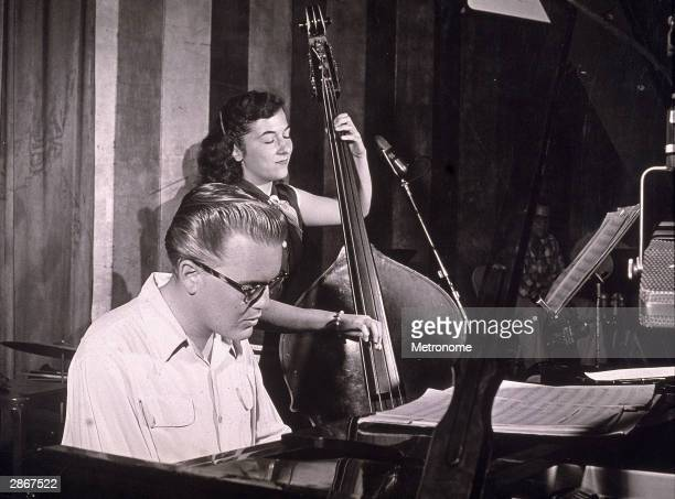 Pianist in a recording studio, accompanied by Bonnie Wetzel, circa 1957.