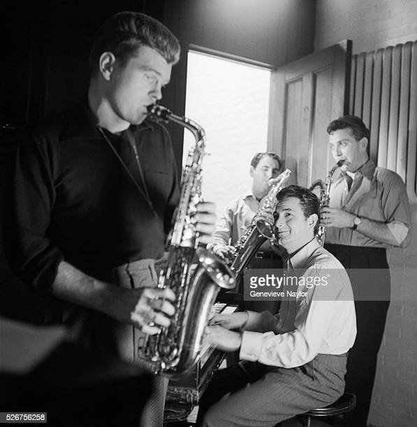 """Pianist Joe Bushkin teaches actor Barry Nelson how to play the saxophone for the Broadway production of Garson Kanin's """"Rat Race""""."""