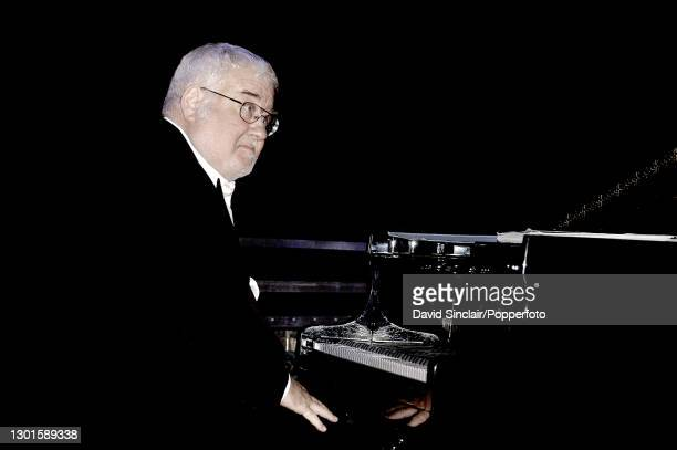 Pianist John Horler performs live on stage at The Guildhall in London on 7th July 2004.