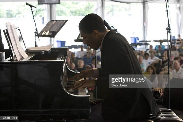 Pianist Jonathan Batiste of the Juilliard Jazz Orchestra on stage in the ATT/WWOZ Jazz Tent at the 38th Annual New Orleans Jazz Heritage Festival in...