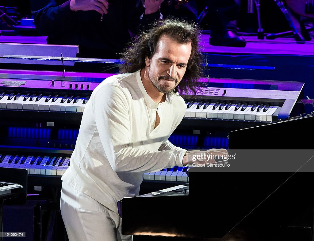 Pianist, keyboardist, composer, and music producer Yanni performs during Yanni World Tour 2014 at Mann Center For Performing Arts on August 23, 2014 in Philadelphia, Pennsylvania.