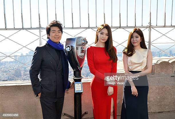 Pianist Lang Lang Kang Minkyung and Lee Haeri of pop duo Davichi visit The Empire State Building on October 23 2015 in New York City