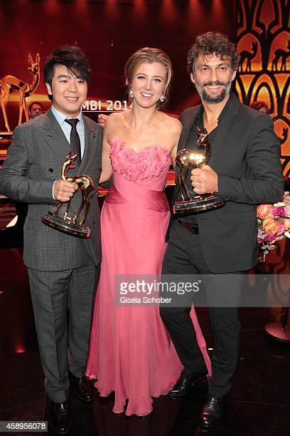 Pianist Lang Lang, Nina Eichinger, Jonas Kaufmann during the Bambi Awards 2014 show on November 13, 2014 in Berlin, Germany.