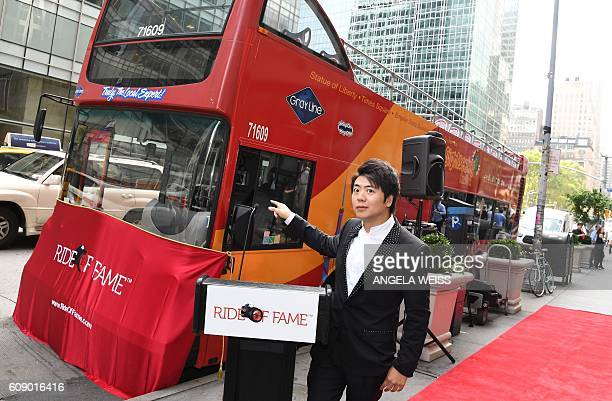 Pianist Lang Lang poses for pictures before he is inducted into the prestigious Ride of Fame in celebration of his role as New York City's first...
