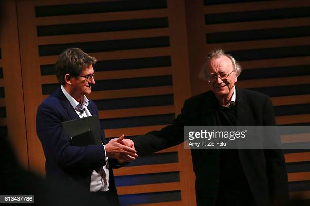 Pianist lecturer and Liszt interpreter Alfred Brendel shakes hands with British journalist Principal of Lady Margaret Hall Oxford and the former...
