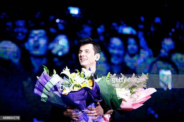 Pianist Maksim Mrvica performs on the stage during his China Tour Shanghai Station at Shanghai Gymnasium on December 3 2014 in Shanghai China