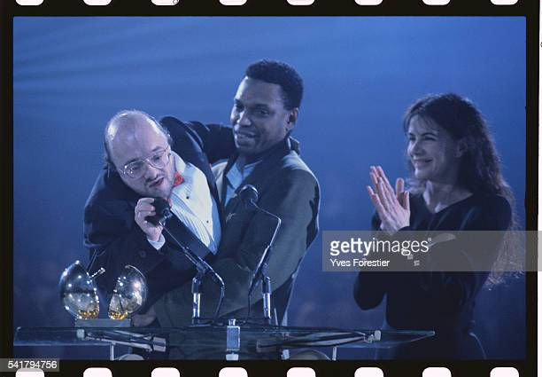 Pianist Michel Petrucciani lifted by a friend, receives an award, at the 5th Victoires de la Musique music awards ceremony.