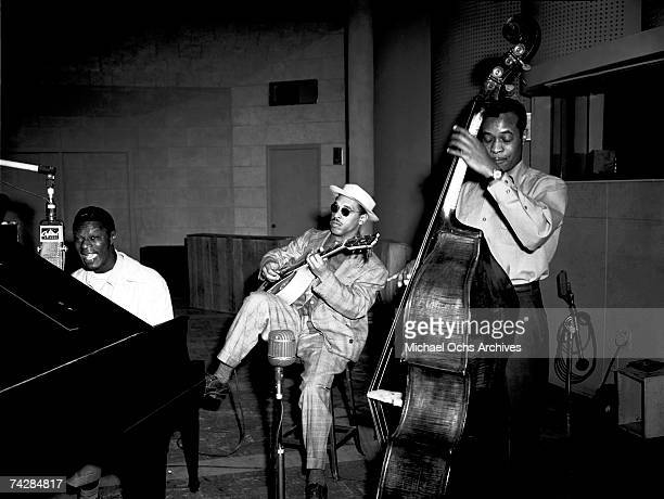 Pianist Nat 'King' Cole guitarist Oscar Moore and bassist Johnny Miller of the Nat 'King' Cole Trio record in Capitol Records studios on March 15...