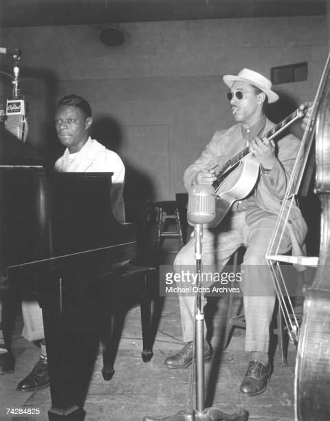 Pianist Nat 'King' Cole guitarist Oscar Moore and bassist Johnny Miller of the 'Nat 'King' Cole Trio' record in Capitol Records studios on March 15...