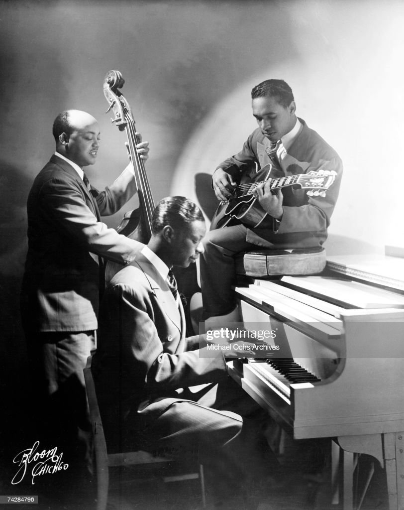 Pianist Nat 'King' Cole, guitarist Oscar Moore and bassist Wesley Prince of the 'Nat 'King' Cole Trio' pose for a portrait in circa 1938 in Los Angeles, California.