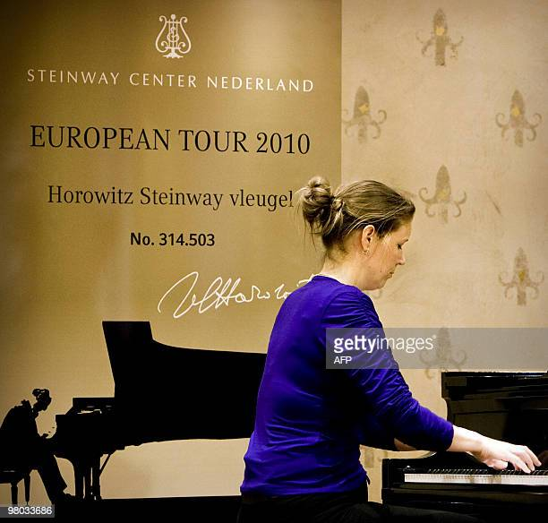 A pianist on March 25 2010 plays on the Steinway piano which belonged to USRussian virtuoso pianist Vladimir Horowitz in the Robijn concert hall in...